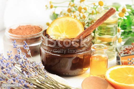 Jar of chocolate face mask with aroma orange oil and lavender blossom.