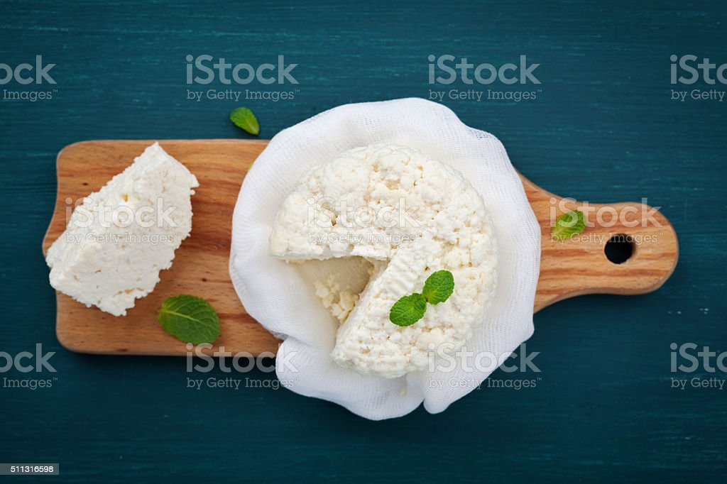 Homemade cottage cheese or curd, rustic style, top view stock photo