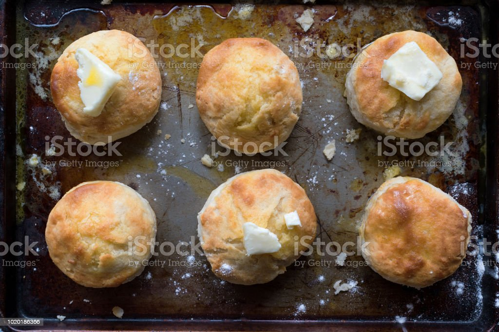 Homemade country biscuits with butter flat lay stock photo