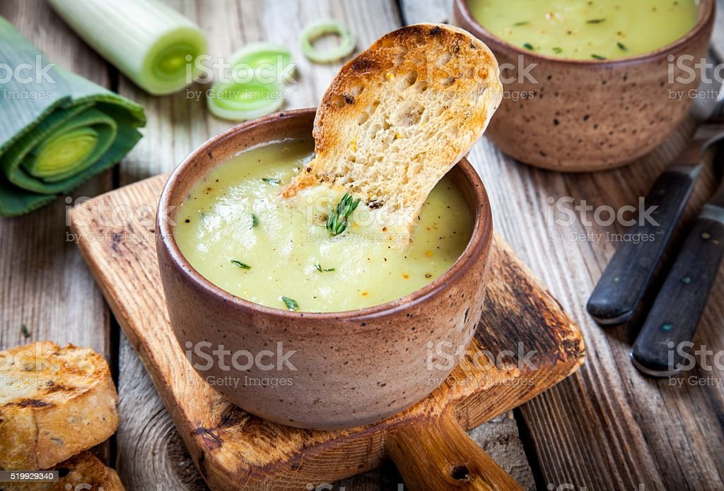 homemade cream of leek soup with croutons stock photo