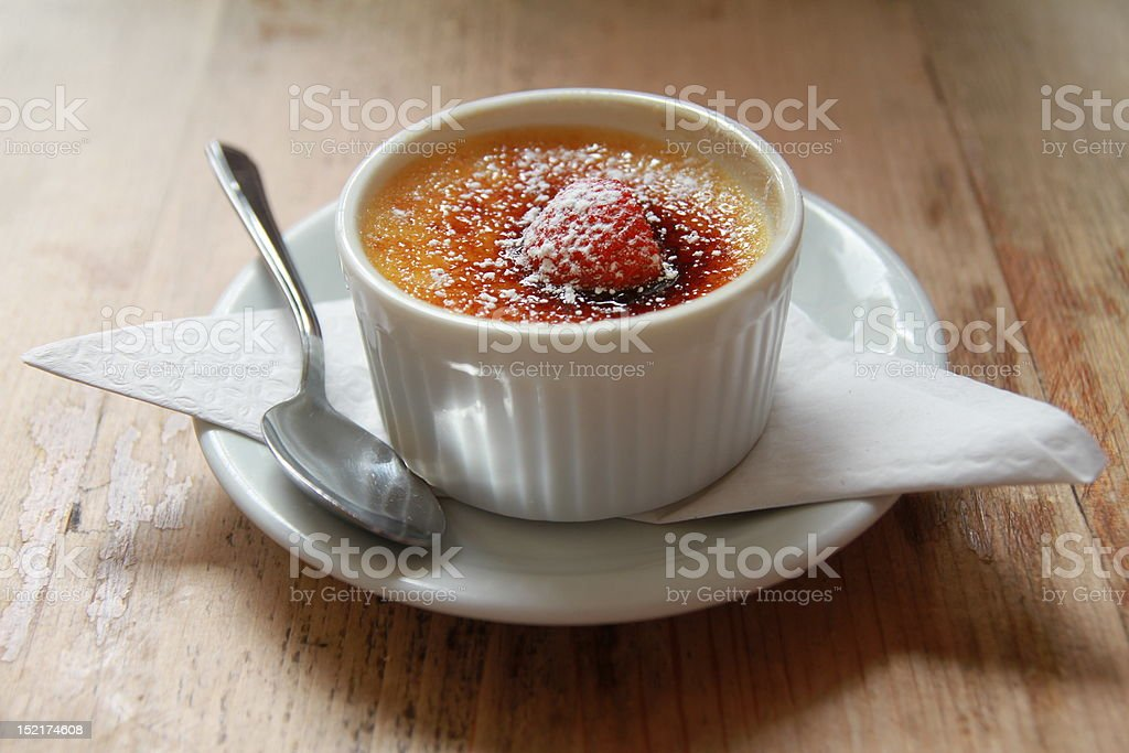 Homemade creme brulee on a wooden table stock photo
