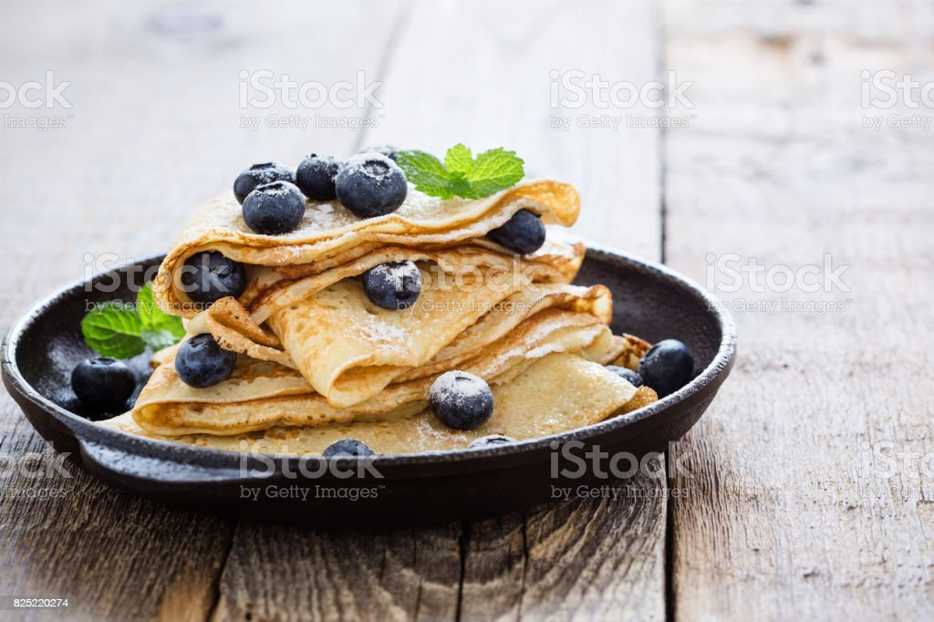 Homemade  crepes served with fresh blueberries stock photo