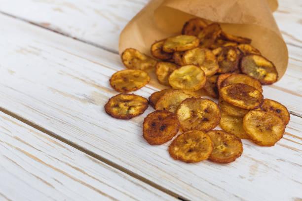 Homemade crispy Banana chips. Vegeterian and vegan concept. stock photo