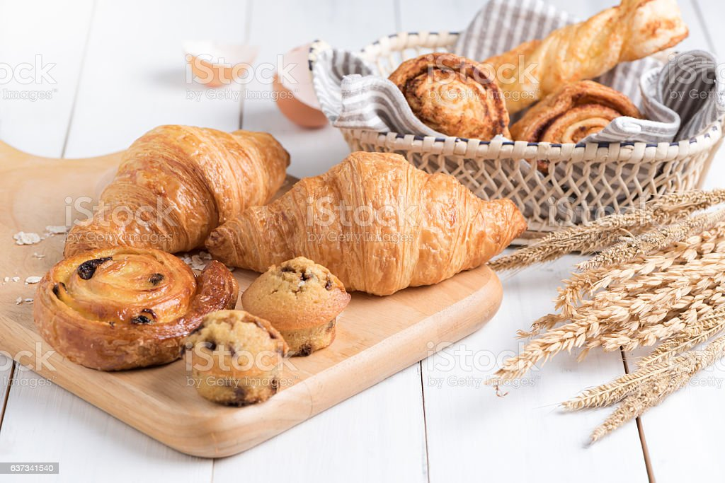 Homemade croissant  on white wood background stock photo