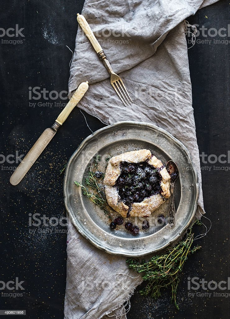Homemade crostata or galette with blueberries stock photo