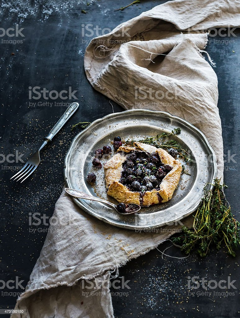 Homemade crusty pie or galette with blueberries stock photo
