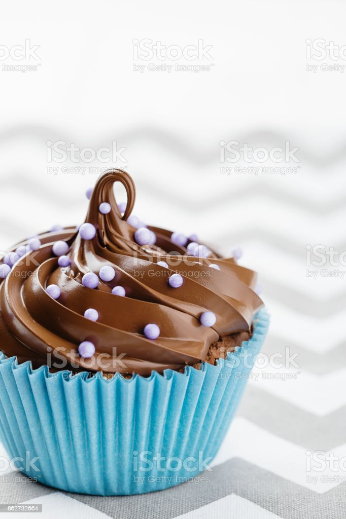 Homemade cupcake with chocolate cream stock photo