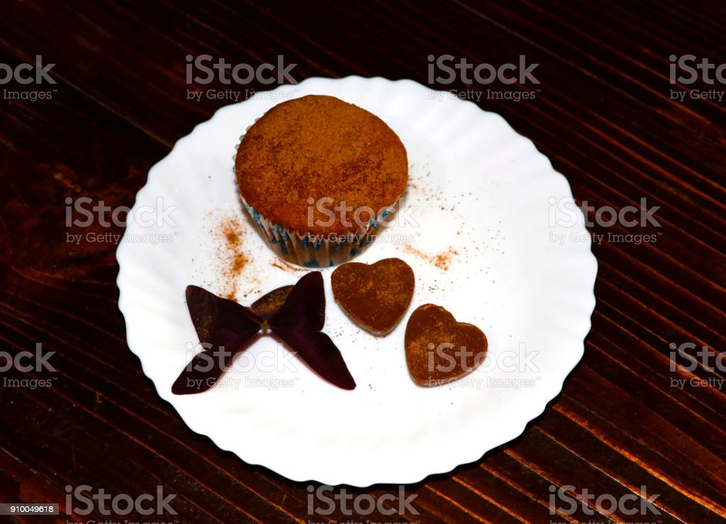 Homemade cupcake with heart shaped candies stock photo