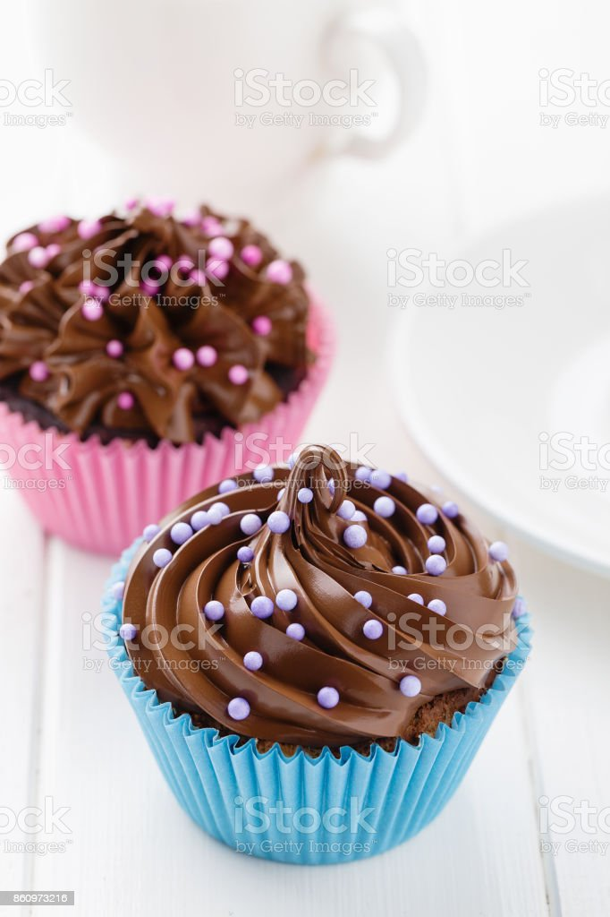 Homemade cupcakes with chocolate cream stock photo