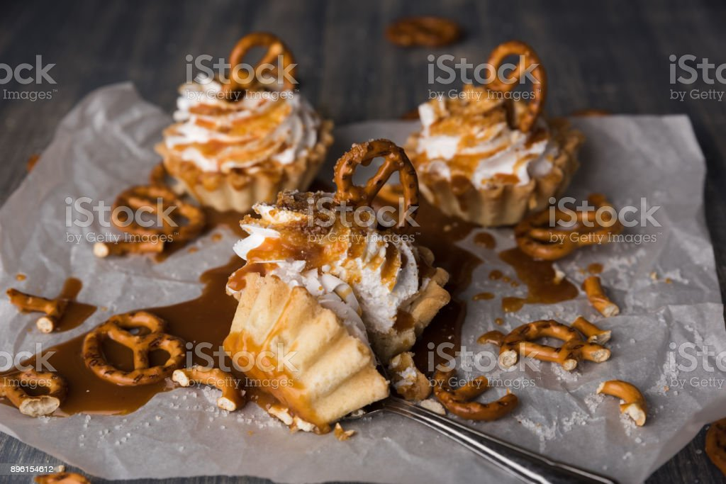 Homemade cupcakes with salted caramel and pretzels. stock photo