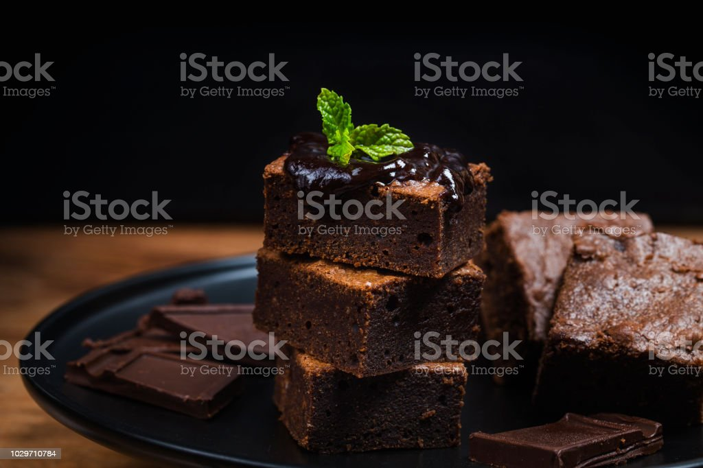 Homemade Dark Chocolate Brownies Topping With Almond Slices And Mint