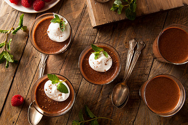 homemade dark chocolate mousse - chocolate mousse stock photos and pictures