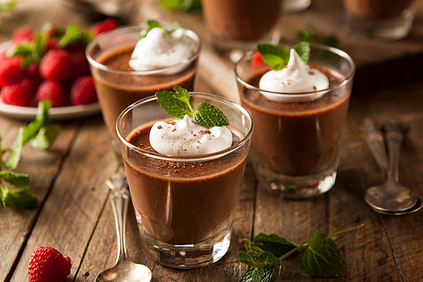 Homemade Dark Chocolate Mousse Homemade Dark Chocolate Mousse with Whipped Cream pudding stock pictures, royalty-free photos & images