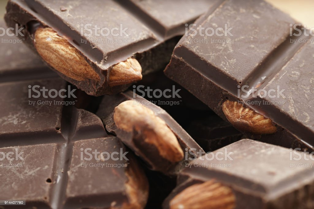 Homemade Dark Chocolate With Almond Nuts On Wooden Board Stock Photo