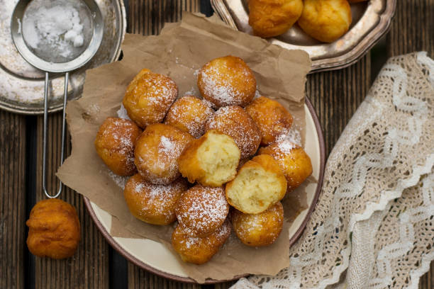 Homemade deep fried sweet ricotta fritters Homemade deep fried sweet ricotta fritters with powdered sugar fritter stock pictures, royalty-free photos & images