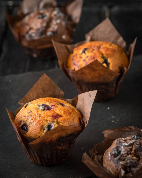 Homemade delicious chocolate cupcakes with fresh berries stock photo