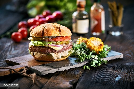 Homemade delicious hamburger  on aged wooden table