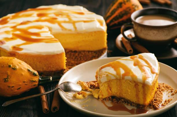 Homemade delicious pumpkin cheesecake with caramel sauce. stock photo