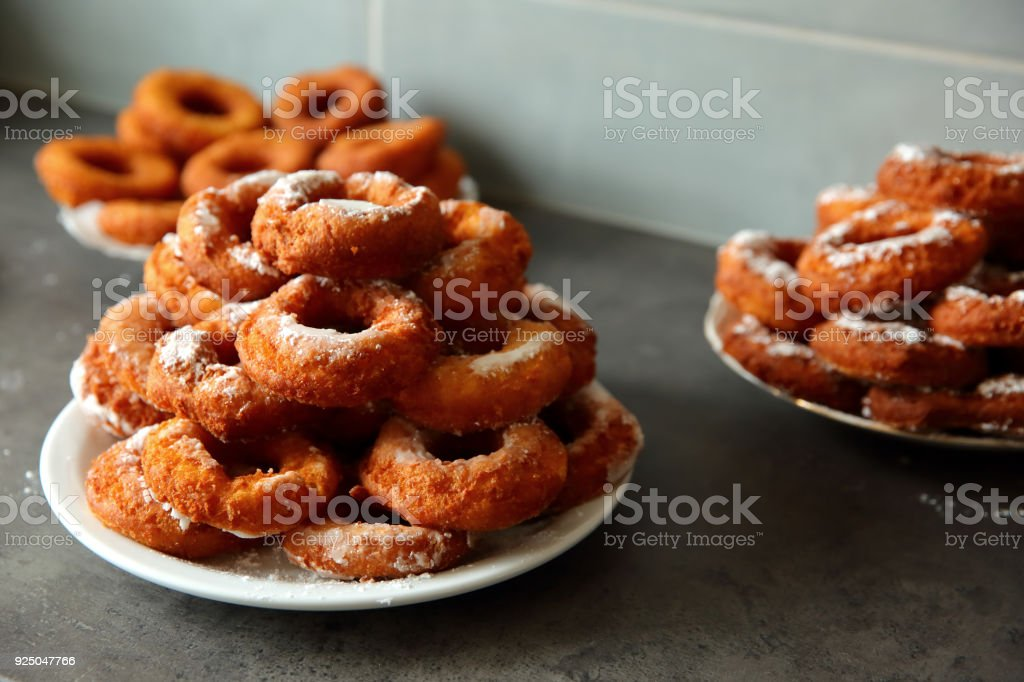 A homemade donut, despite the non-ideal shape, is a taste superior to any other donut purchased in a store or in a supermarket because it was created from the work of its own hands. stock photo