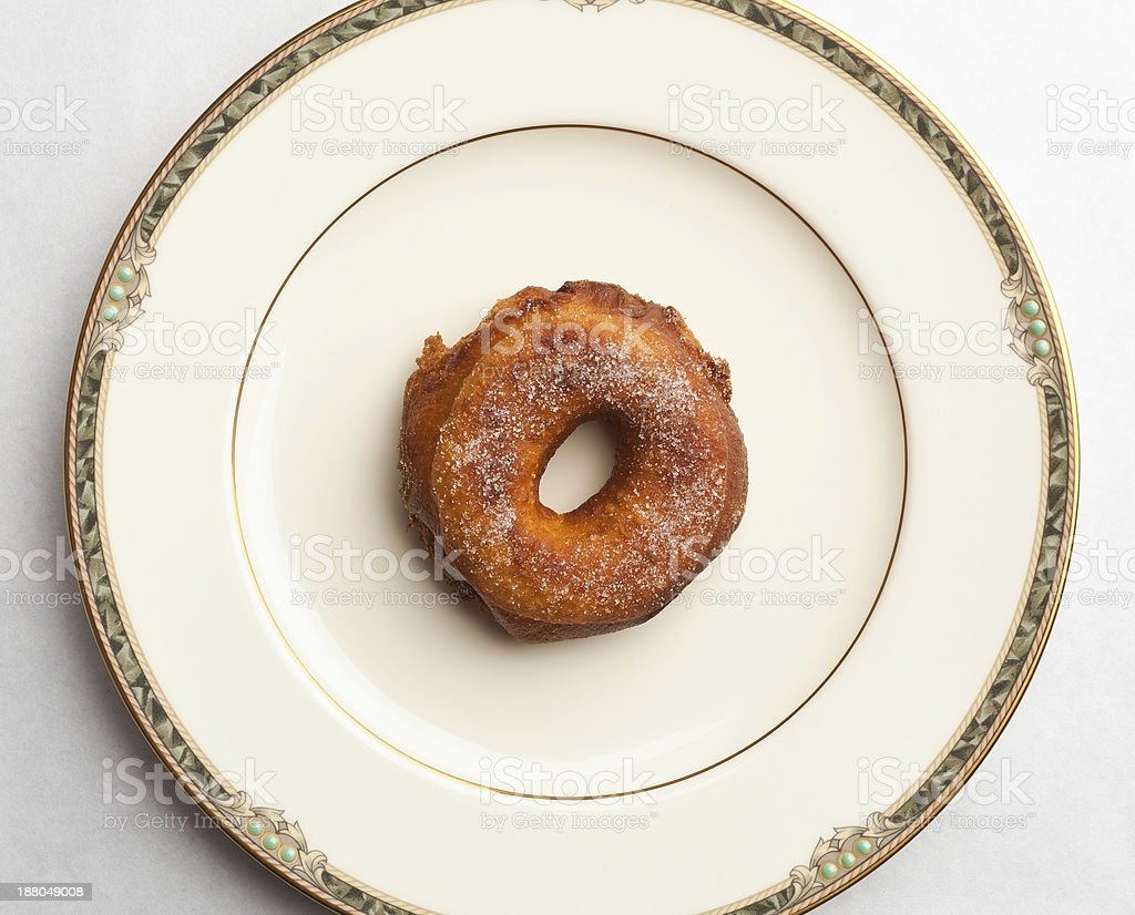 Homemade doughnut on fine china plate stock photo