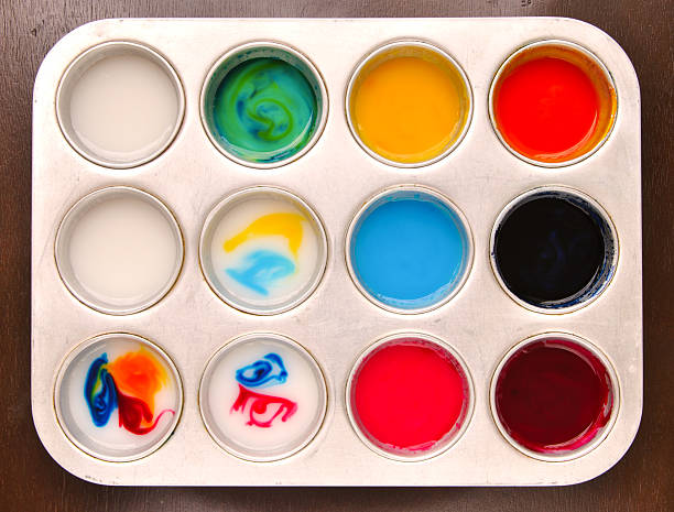 Homemade edible paint made from cornstarch Homemade edible paint made from cornstarch and food coloring in a muffin tray muffin tin stock pictures, royalty-free photos & images