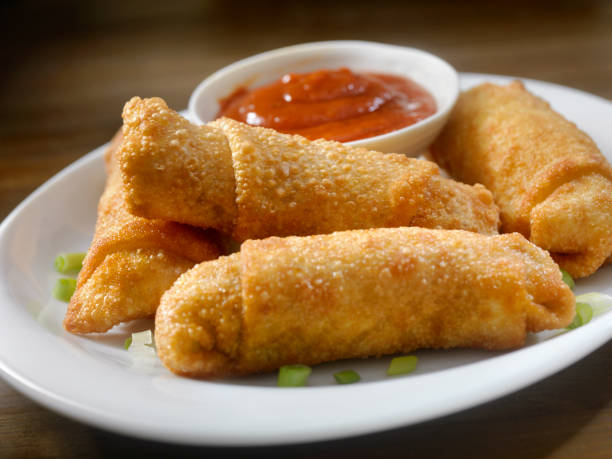 homemade egg rolls with dipping sauce - chinese food stock photos and pictures