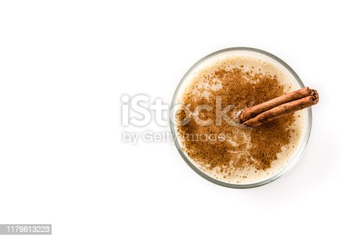 Homemade eggnog with cinnamon in glass isolated on white background