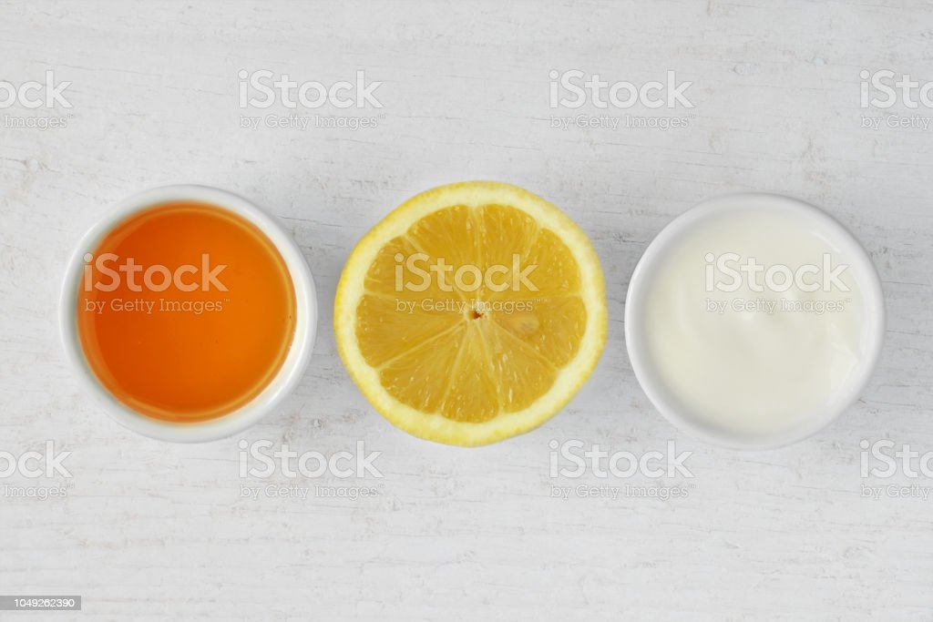 Homemade face mask made out of honey, lemon and yogurt stock photo