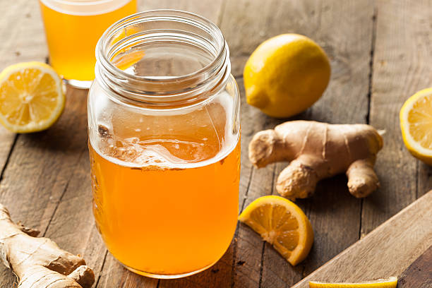 Homemade Fermented Raw Kombucha Tea Homemade Fermented Raw Kombucha Tea Ready to Drink fermenting stock pictures, royalty-free photos & images