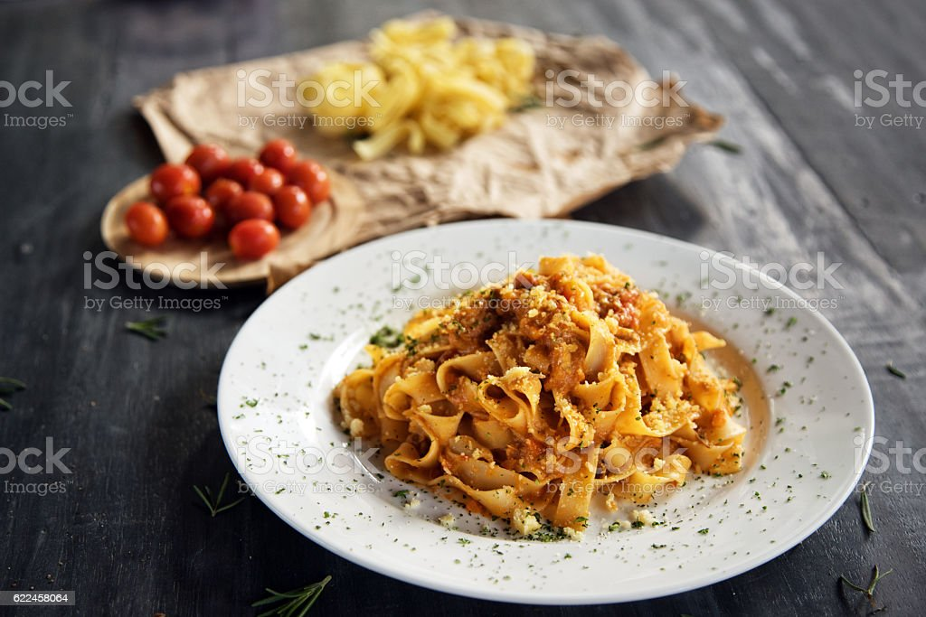 Homemade fettuccine pasta with bolognese sauce stock photo