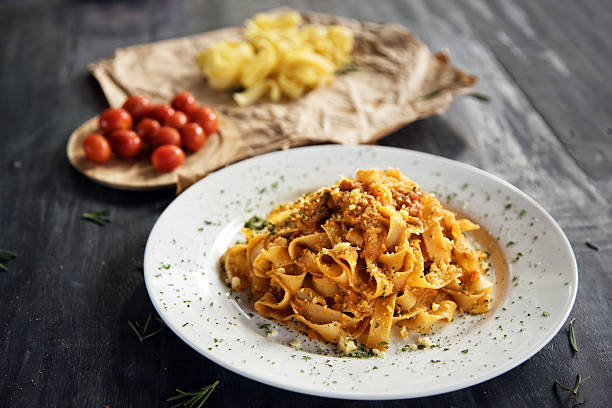 Homemade fettuccine pasta with bolognese sauce Homemade fettuccine pasta with bolognese sauce tagliatelle stock pictures, royalty-free photos & images
