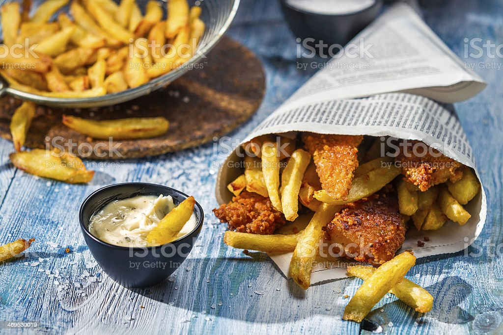 Homemade Fish & Chips and sauce stock photo
