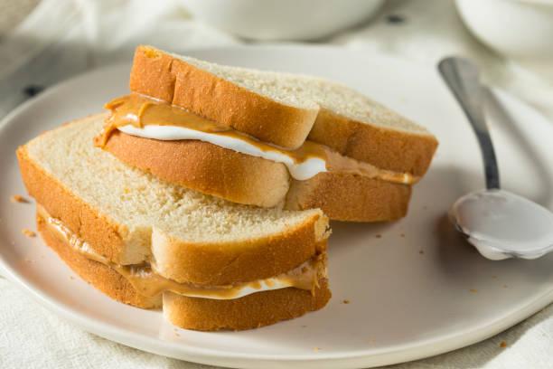 homemade fluffernutter marshmallow peanut butter sandwich - fluffy stock photos and pictures