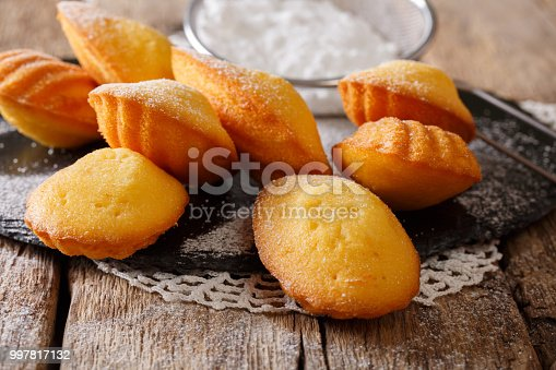 istock Homemade French biscuit Madeleine close-up on the table. Horizontal 997817132