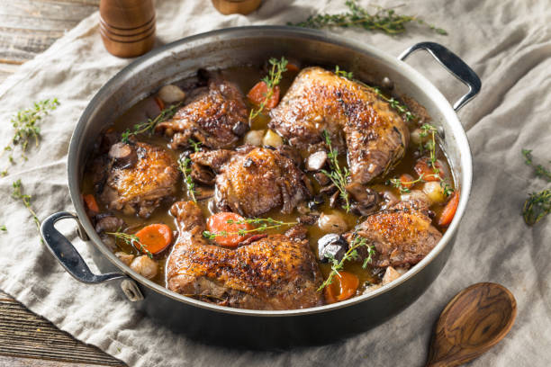 Homemade French Coq Au Vin Chicken Homemade French Coq Au Vin Chicken with Veggies and Sauce stew stock pictures, royalty-free photos & images