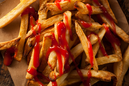 Homemade French Fries Covered in Ketchup