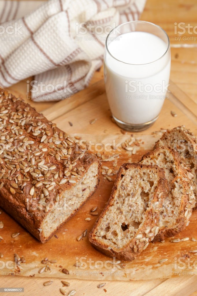 Homemade fresh baked bread with glass of milk stock photo