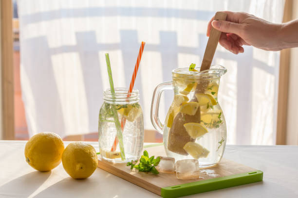 Homemade fresh lemonade pitcher, preparation of lemonade Homemade lemonade pitcher, preparation of lemonade, hand lemon juice stock pictures, royalty-free photos & images