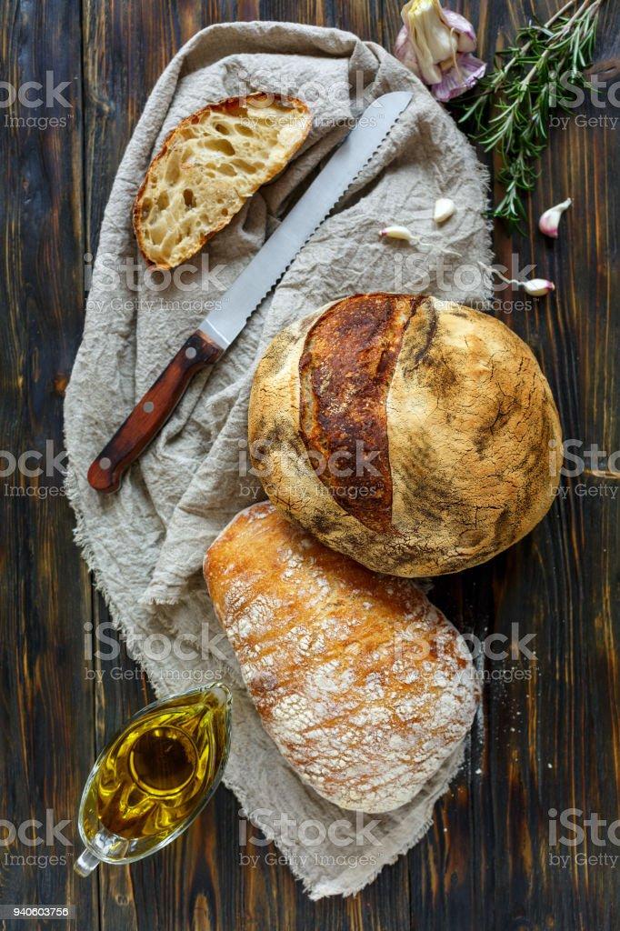 Homemade freshly baked bread on linen cloth. stock photo