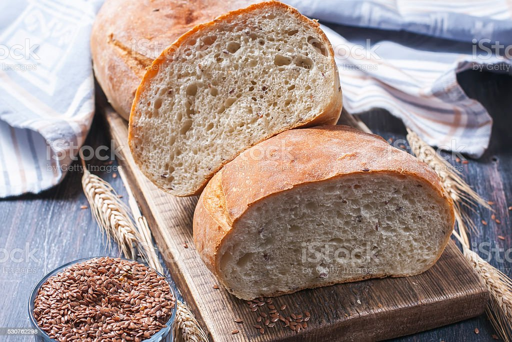 Homemade  freshly baked  bread with flax stock photo