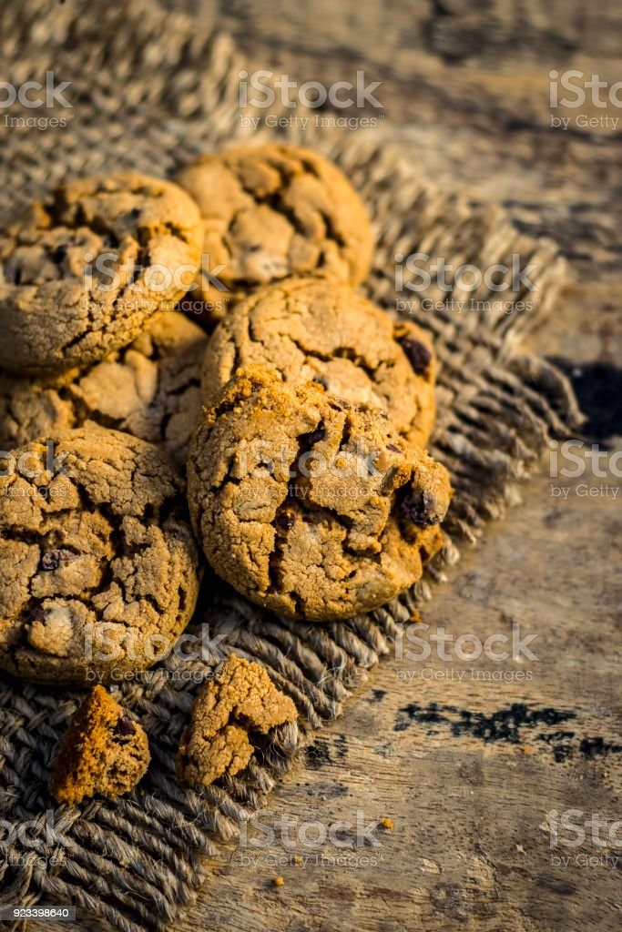 Homemade freshly baked chocolate chip cookies on gunny background. stock photo