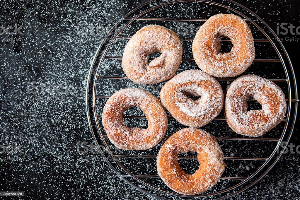 Homemade fried donuts with sugar stock photo
