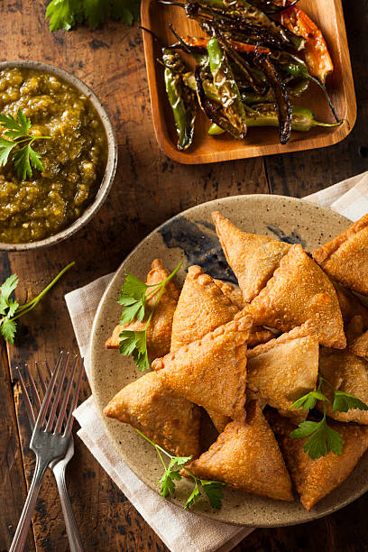 homemade fried indian samosas - samosa stock photos and pictures