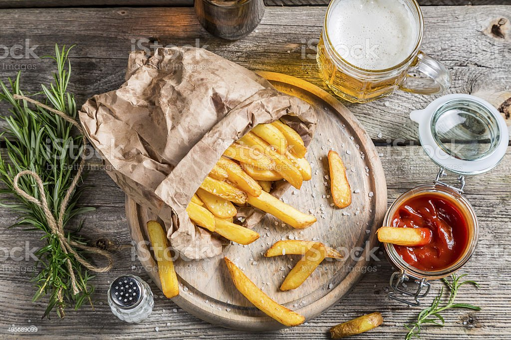 Homemade fries served with beer royalty-free stock photo