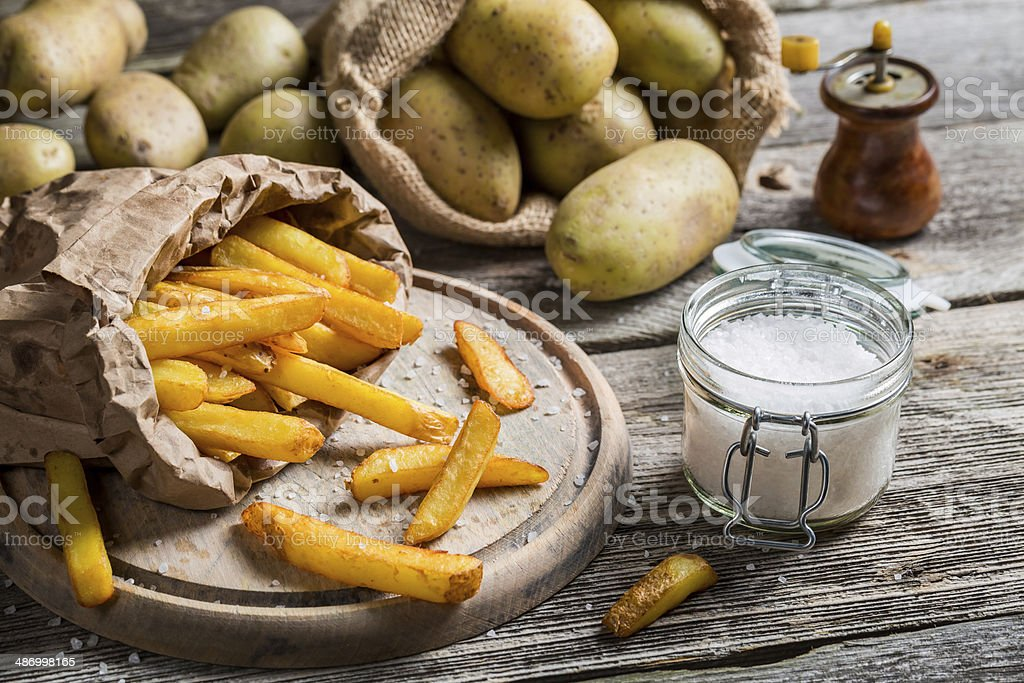 Homemade fries with salt and pepper stock photo