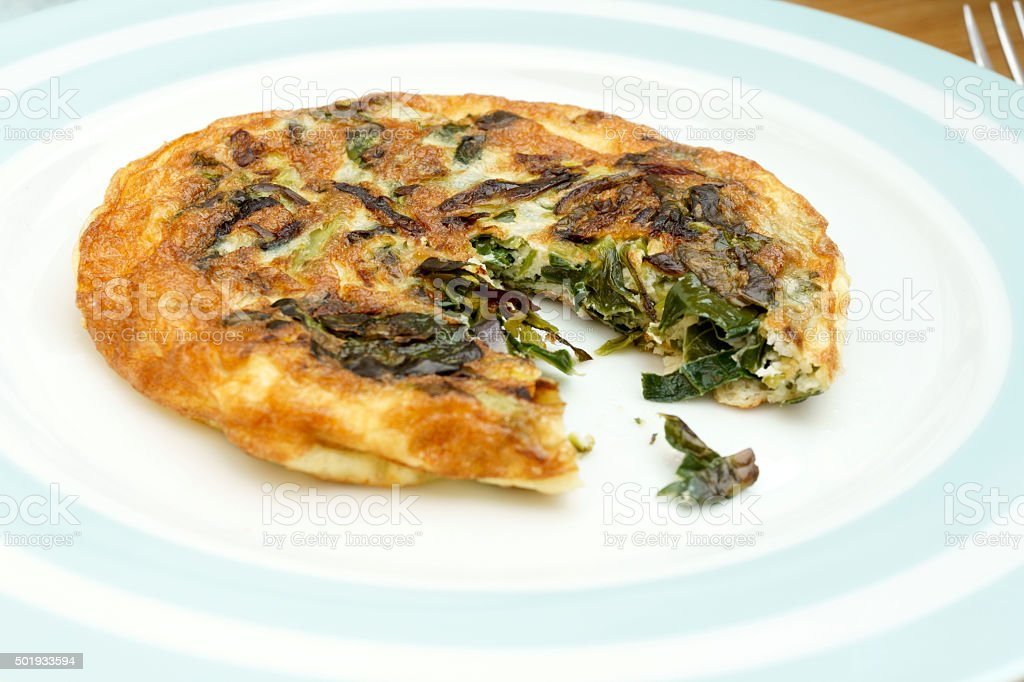 Homemade Frittata with onions, vegetable and parmesan cheese. stock photo