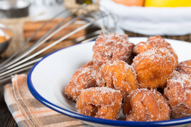 Homemade fritters with sugar Homemade fritters with sugar and its ingredients fritter stock pictures, royalty-free photos & images
