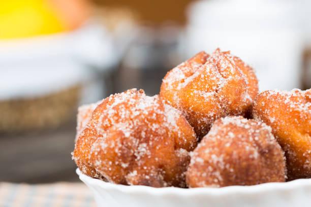homemade fritters with sugar - fritto foto e immagini stock