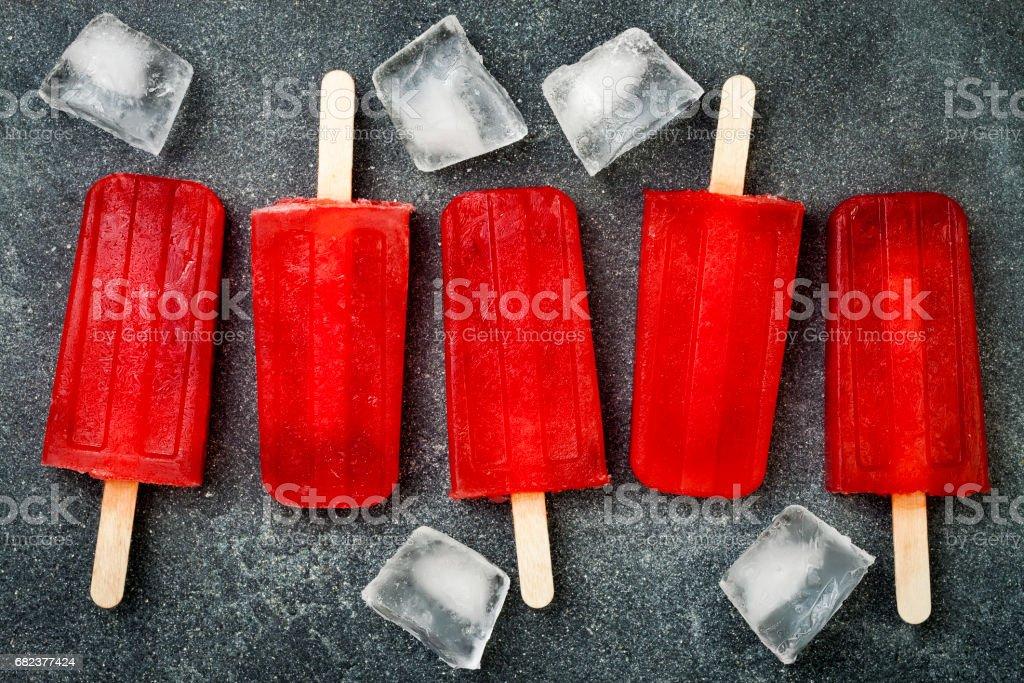 Homemade frozen blood orange natural juice alcoholic popsicles - paletas - ice pops. Overhead, flat lay, top view, zbiór zdjęć royalty-free