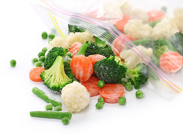 homemade frozen vegetables broccoli,cauliflower,carrots,grean beans,peas plastic bag stock pictures, royalty-free photos & images